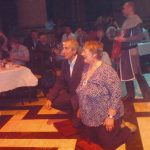Carol Dealey and Dan Bader kneel to be 'knighted'